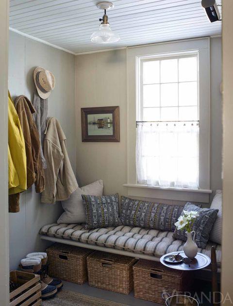 Cushion in a Classic Cloth stripe; baskets, Restoration Hardware; ceiling fixture, Rejuvenation.