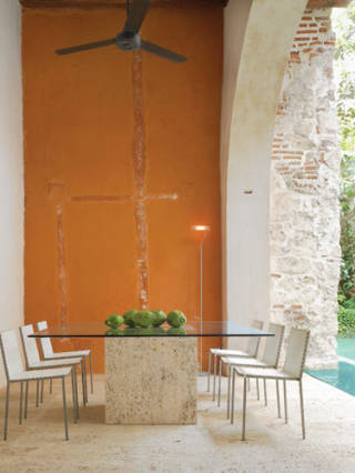 Coralline rock table base designed by Jean-Claude Bessudo. Tugó chairs.